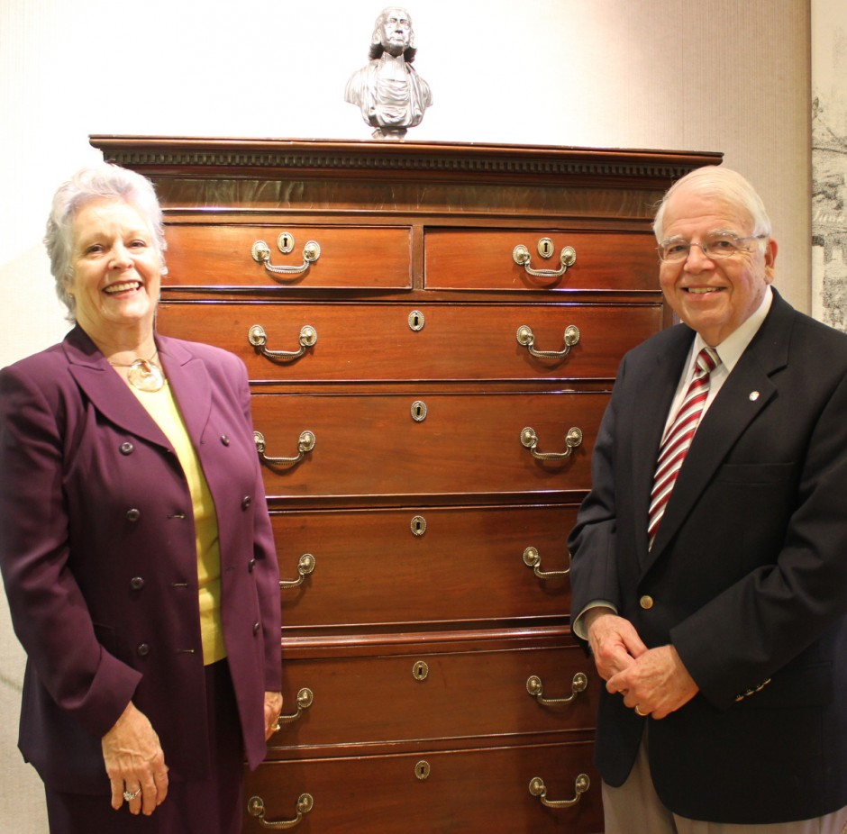 Jackie Bolden, World Methodist Museum director, and Rev. Don Rankin, Friends of the Museum chair, stand before the John Wesley chest-on-chest.