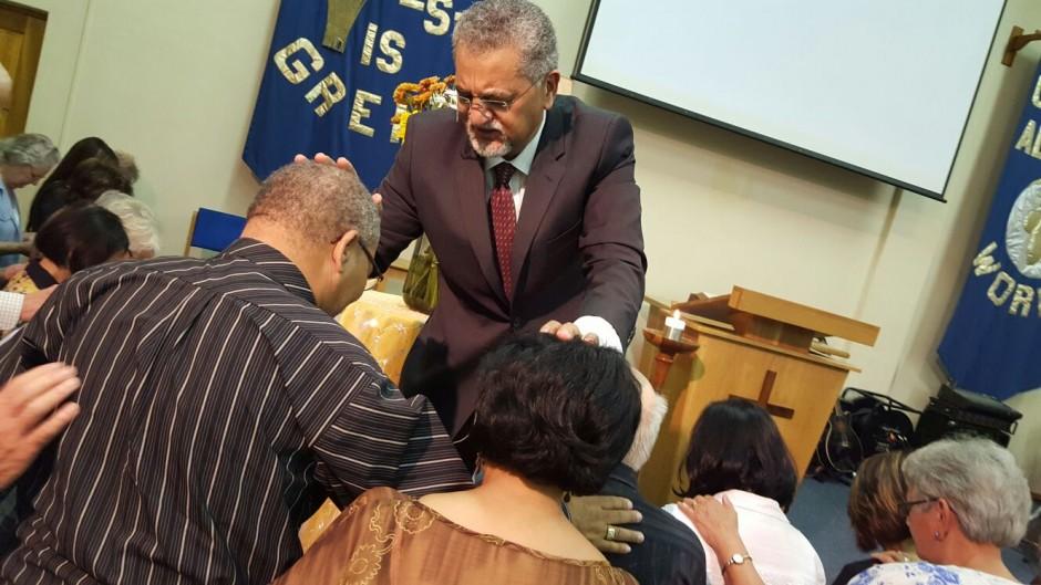 Bishop Abrahams praying for Rev Ronnie van Eck & Hazel van Eck