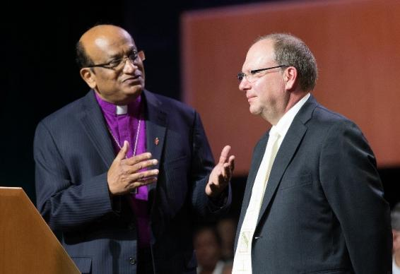 Bishop Sudarshana Devadhar (left) of the Boston Episcopal Area welcomes the Rt. Rev. Chris Giesler, representing the Moravian Church Northern & Southern Provinces